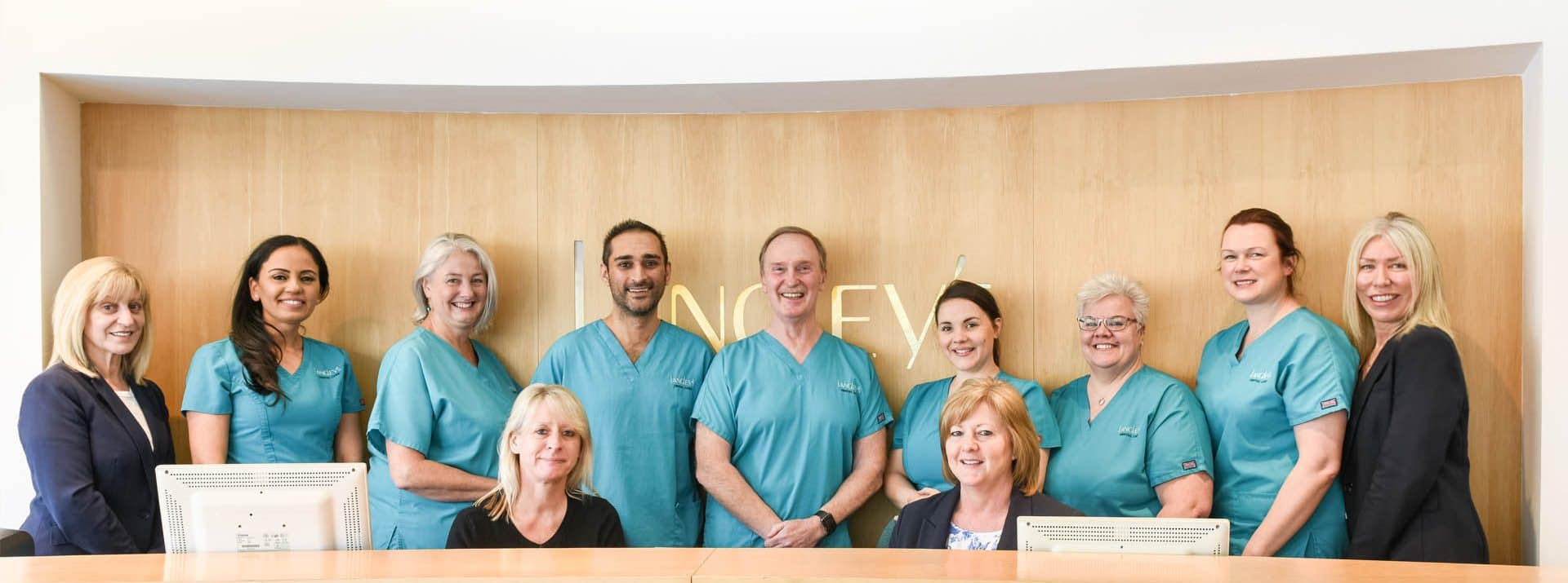 Langley's Team behind reception desk