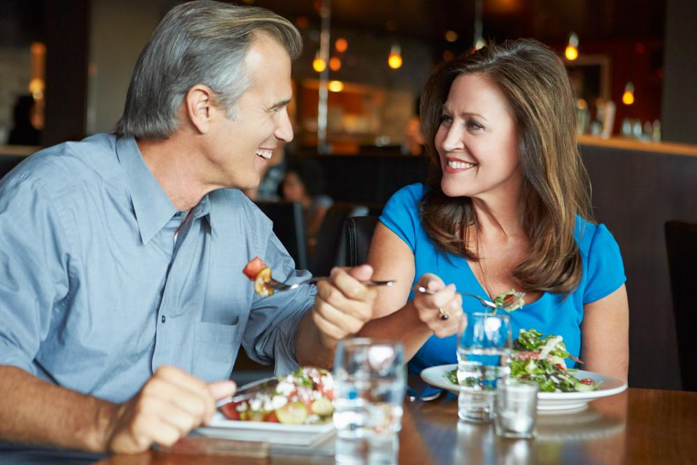 Older couple eating out at restaurant