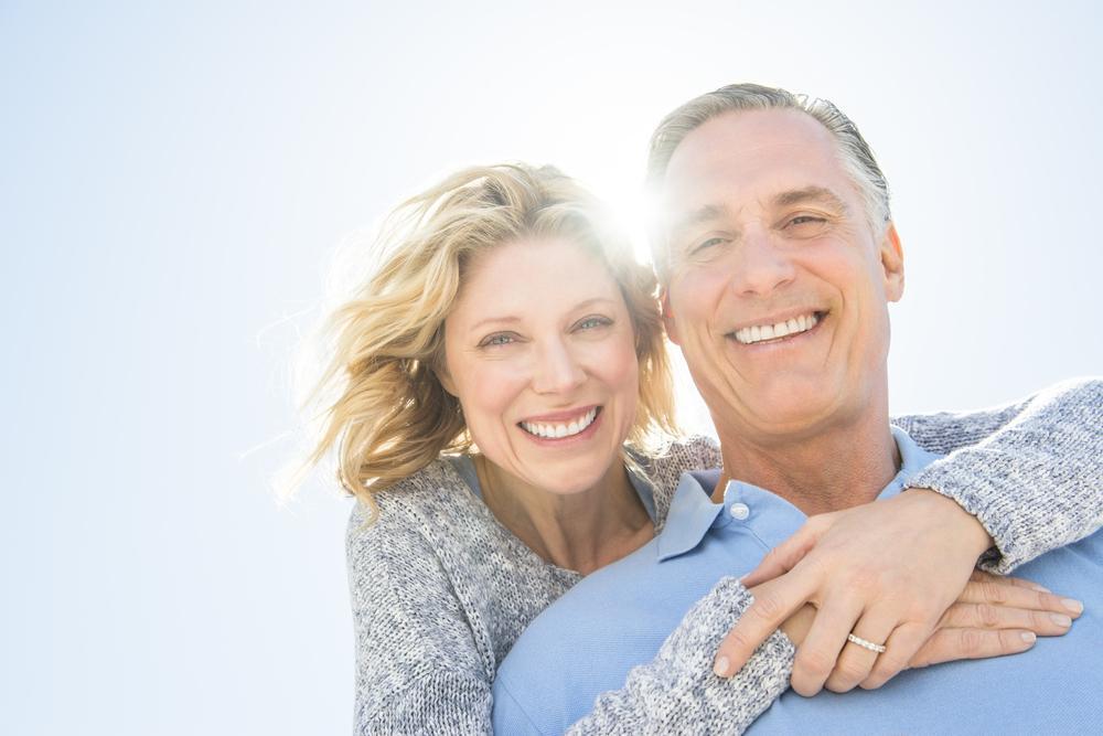 Older couple smiling implants